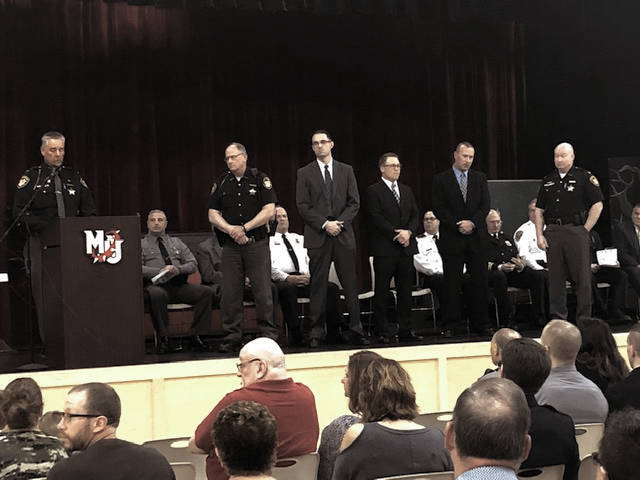 From left, Sheriff David Duchak honors Sgt. Chris Bobb, Det. Steve Hickey, Det. Aaron Garbig, Lt. Jason Moore and Chief Deputy Steve Lord during the fifth annual Law Enforcement Awards Ceremony at Milton-Union High School on Thursday. They were honored for their work during the murder case of Samantha Freels on Jan. 12, 2018.