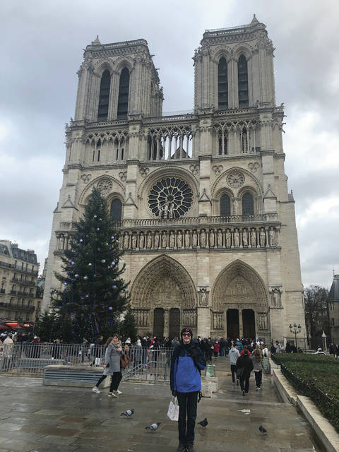 Provided photo Troy High School student Noah Palombi stands in front of the Notre Dame Cathedral during a visit to Paris last year. Monday, the 12th-century cathedral suffered a devastating fire.