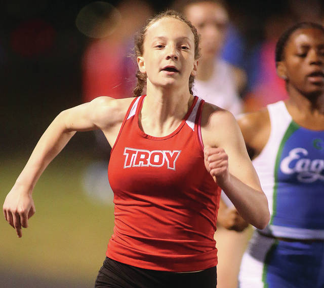 Lee Woolery | Miami Valley Sunday News Troy's Hannah Falknor wins the 200 Friday at the Herb Hartman Invitational at Troy Memorial Stadium.
