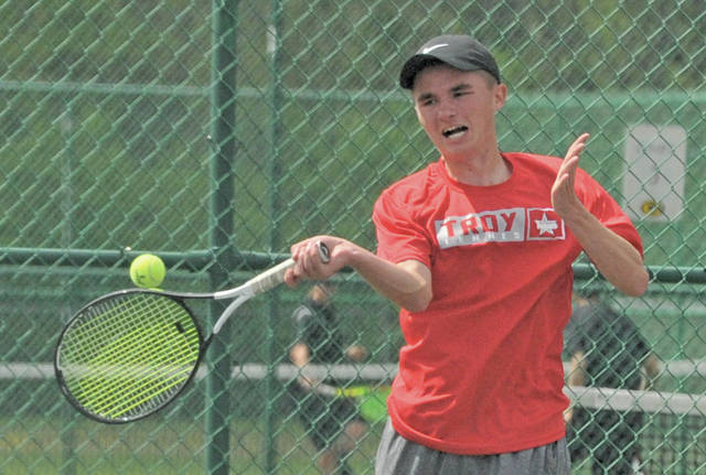 Josh Brown|Miami Valley Today Troy's Nathan Kleptz hits a forehand during a first-round match at the GWOC tournament Thursday at Centerville High School.