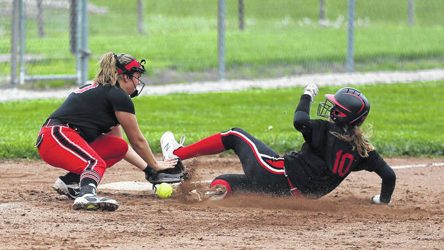 Lee Woolery|Miami Valley Sunday News Tippecanoe's Kaela May slides safely into third base as the throw gets away from the third baseman against Milton-Union Saturday at Tippecanoe Middle School.