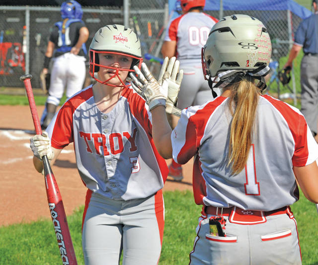 Josh Brown|Miami Valley Today Troy's Briana Lavender (3) is congratulated by Josie Rohlfs (1) after scoring a run in the first inning of Monday's Division I sectional tournament game against Xenia at Xenia High School.