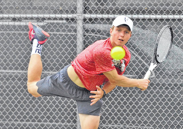 Josh Brown|Miami Valley Today Milton-Union's Nathan Brumbaugh follows through on a serve at the Division II sectional tournament Tuesday at Troy High School.