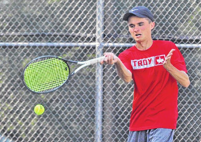 Josh Brown|Miami Valley Today Troy's Nathan Kleptz hits a forehand at the Division I sectional tournament Wednesday at Troy High School.