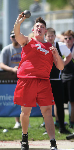 Lee Woolery Miami Valley Today Troy's Jesse Westmeyer throws the shot put at the GWOC meet Wednesday at Troy Memorial Stadium.
