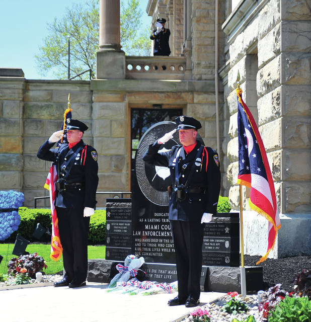 "Officers salute as ""Taps,"" is played at the Miami County Law Enforcement Memorial on Wednesday."