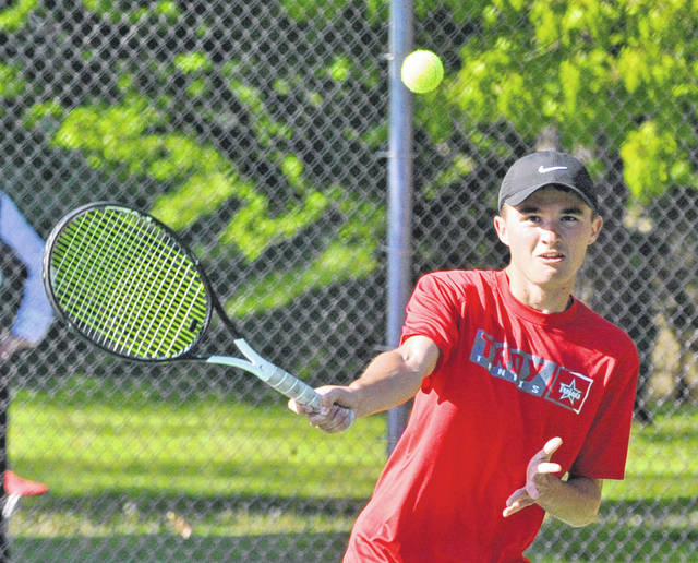 Josh Brown|Miami Valley Sunday News Troy's Nathan Kleptz hits a volley at the net at the Divison I sectional tournament Saturday at Troy Community Park.