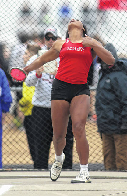 Lee Woolery | Miami Valley Sunday News Troy's Lenea Browder captured Greater Western Ohio Conference titles, and set meet records, in both the discus and shot put Friday at Troy Memorial Stadium.