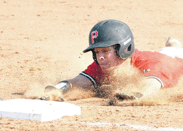Josh Brown|Miami Valley Today Newton's Ryan Mollette slides into third base during the first inning of a Division IV sectional tournament game against Catholic Central Wednesday at Newton.