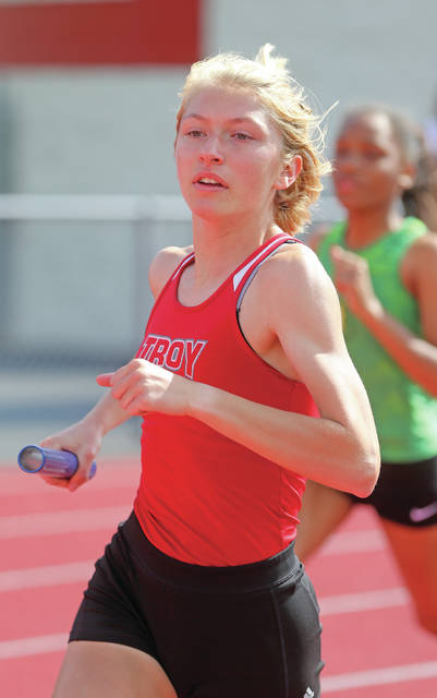 Lee Woolery|Miami Valley Today Troy's Olivia Tyre runs a leg of the 4x800 relay at the Division I district meet Wednesday at Piqua High School.