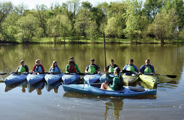 Andrew Schlagel of Great Miami Outfitters in Miamisburg works with Upper Valley Career Center Environmental Occupations students at Willowbrook on Wednesday during the first Paddle Safety Introduction course at the school. The course was made possible due to a donation by the DARDAB committee. ©2019 Miami Valley Today, All rights reserved