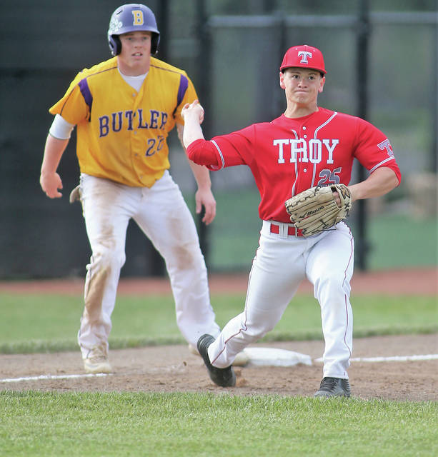 Lee Woolery|Miami Valley Today Troy third baseman Matt Bigley holds a Butler runner at third base and throws to first for an out during Tuesday's Division I sectional final at Centerville High School.