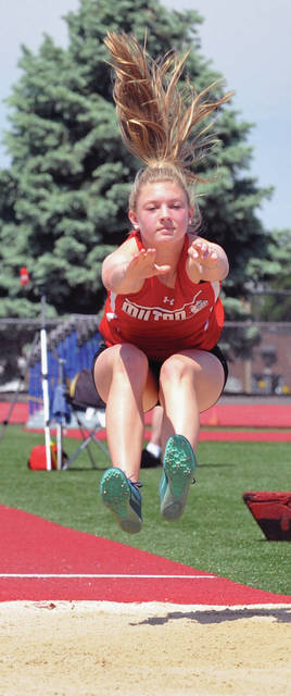 Josh Brown|Miami Valley Today Milton-Union's Morgan Grudich competes in the long jump at the Division II regional meet Saturday at Piqua High School.