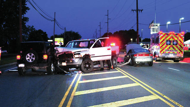 Miami Co. Sheriff's Deputies investigate a three-vehicle crash on Co. Rd. 25-A just north of Monroe-Concord Road as Tipp City EMS and firefighters work with victims on Monday evening. ©2019 Miami Valley Today. All rights reserved
