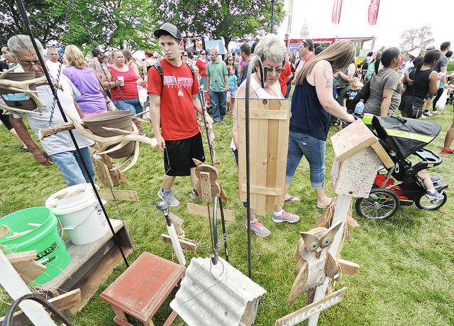 Miami Valley Today file art Festival-goers flooded the streets and levee area for the food booths, fun, entertainment, contests, and crafts during the 2017 Troy Strawberry Festival.