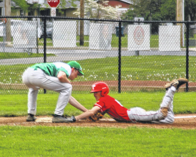 <strong>Austin Kendall slides in safe at third with a triple as Noah McGilton tries to apply the tag in the top of the fourth inning.</strong>