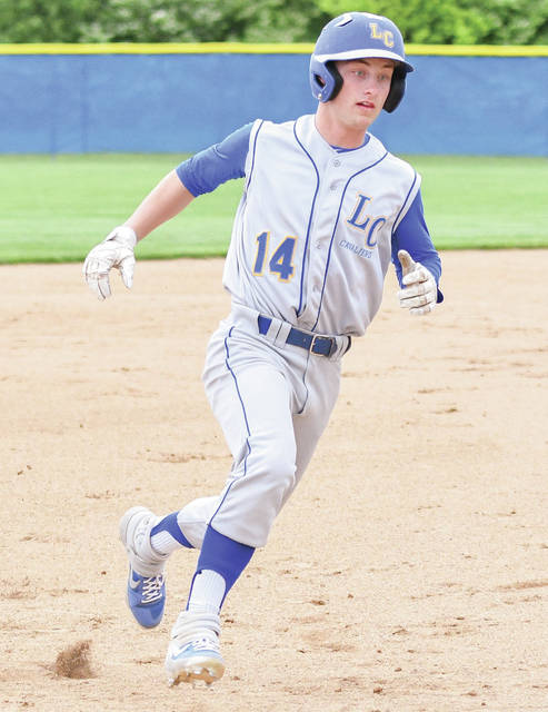 Lehman Catholic leadoff hitter Drew Barhorst heads for third base during the first inning of a Division IV district semifinal on Tuesday in Casstown. Barhorst later scored, and it was the team's only run before play was suspended due to darkness.