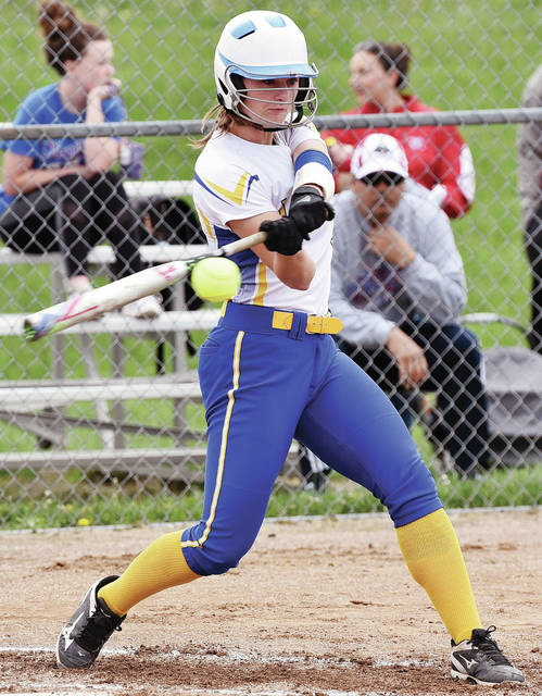 Luke Gronneberg|AIM Media Lehman Catholic's Grace Monnin connects on a pitch against Riverside during a Division IV sectional tournament game Thursday at Riverside.