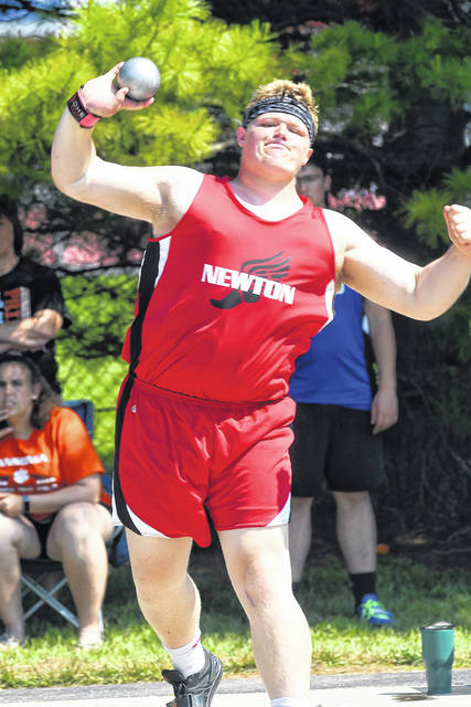 Ben Robinson|GoBuccs.com Newton's Dawson Hildebrand puts the shot Saturday at the Piqua D-III district track and field meet.