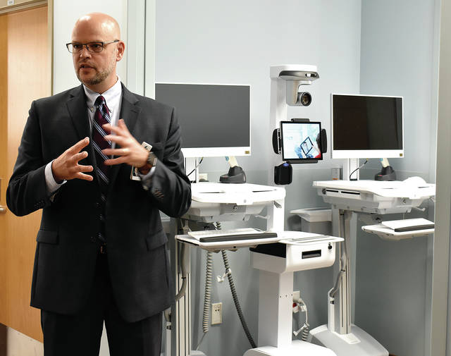 Kettering Health Network Troy Hospital President Eric Lunde explains the state-of-the-art features of the InTouch Health telemedicine equipment to be used at the new Troy facility when it opens next month. Kettering Health Network Troy Hospital Director Eric Lunde displays some of the equipment for use with telemedicine to be used at the new Troy facility when it opens next month.