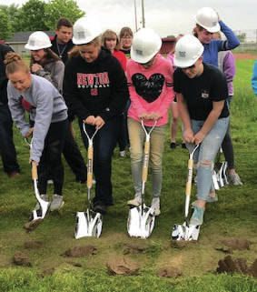 Members of the Newton High School junior class participate in the ground breaking ceremony for the new community Field House on Tuesday. The $2.5 million facility will serve as a community and athletic center. Construction will begin this week and plans to open to the public in December 2019.