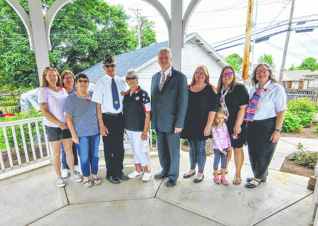 Provided photo From left to right, Jen Rademachir, Cathy Jadwin, Pat Purves, Delbert Prater, Dorothy Prater, Mayor Gibson, Angel Turner, Adalyn Brinkman, Caitlyn Brinkman, and Marlene Shook.