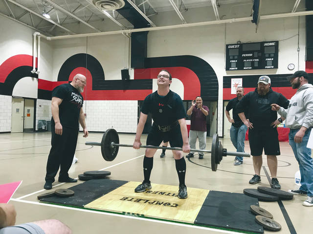 """Provided photo Tristan Yingst of Covington competes in the deadlift event at the Miami County Special Olympics Powerlifting Tournament on May 11 at the Miami County Board of Developmental Disabilities (Riverside). Yingst went on to take first place in the deadlift event. Nine athletes from Miami, Darke and Champaign counties competed. The event was sponsored by Complete Fitness in Tipp City. Miami County took second place as a team, with Darke placing first and Champaign third overall. For more information about Riverside or Miami County Special Olympics, visit <a data-auth=""""NotApplicable"""" href=""""http://www.riversidedd.org/"""" rel=""""noopener noreferrer"""" target=""""_blank"""">www.riversidedd.org</a>."""