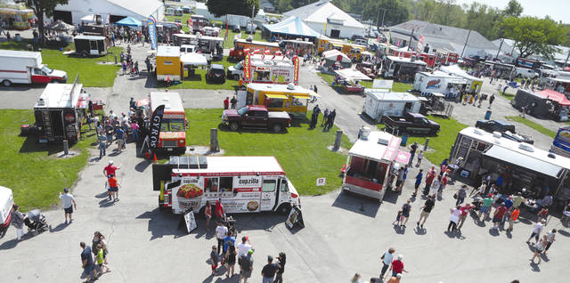 Lee Woolery | For Miami Valley Today An overheard view of the Miami County Fairgrounds where the annual Miami County Food Truck Rally was held Saturday. Thousands of community members packed the grounds to try a wide variety of foods from 62 food trucks.