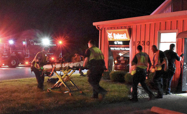 Troy Fire Department medics wheel the victim of a crash that saw the driver's vehicle crash into the Bobcat of Troy business on Archer Drive around 10:45 p.m. on Sunday. It is believed that a medical condition may have played a part in the crash. The victim, a male in his 20s, was transported to Upper Valley Medical Center. His name and condition are not known but his injuries are not thought to be serious. The crash is under investigation by the Troy Police Department.