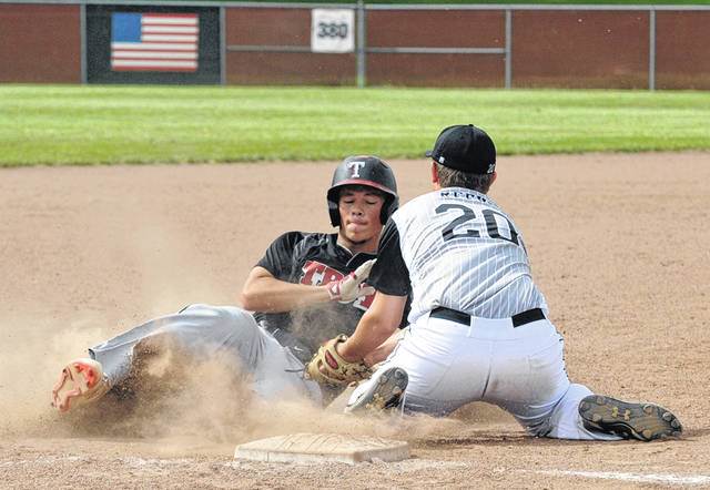Josh Brown|Miami Valley Today file Troy Post 43's J.R. Young, seen here sliding into third base in a game earlier this season, hit a grand slam during last week's Locker Room CWS Tournament in Omaha, Neb.
