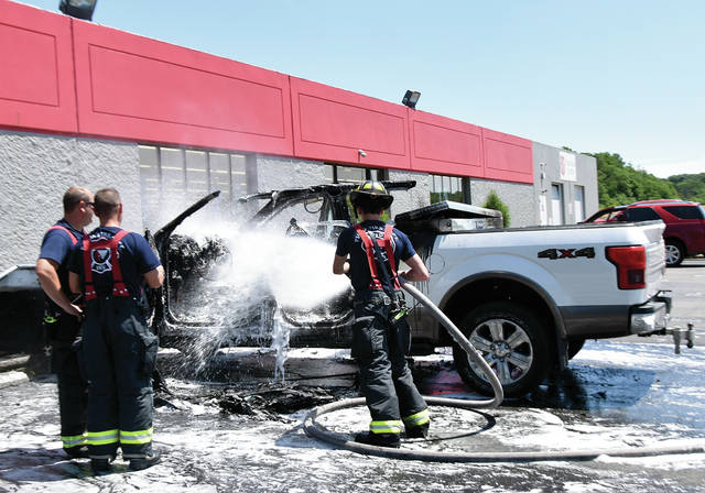 Piqua firefighters extinguish a fire in a pickup truck that broke out in the parking lot of the Salvation Army Story on Looney Road around noon on Wednesday. There were no injuries but the truck was a total loss. No cause has been determined for the fire. ©2019 Miami Valley Today. All rights reserved
