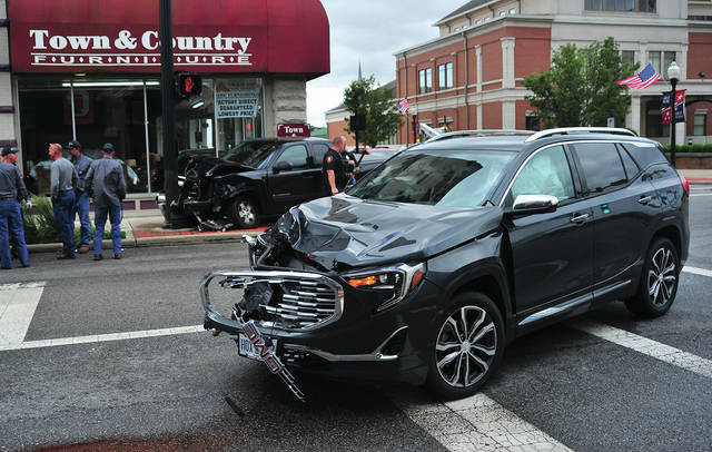 One person was transported from this crash at Water and Wayne Street in Piqua on Thursday. One vehicle was hit a light pole and the Town & Country Furniture building the other remained in the street. Both vehicles suffered heavy damage. No damage was reported to the building. Piqua Police are investigating the crash. ©2019 Miami Valley Today. All rights reserved