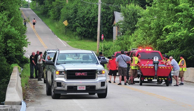 "First Responders, including Miami County Sheriff's Deputies, Miami County Park District officers, Covington Fire and Rescue personnel, prepare to wrap up rescue operations on the Stillwater River at Rangeline Road after a reported ""possible drowning"" was called in earlier. The 17 year old who went into the river was located safe about 20 minutes after the call."
