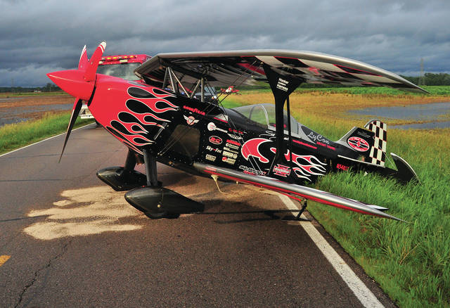 An airplane belonging to well-known air show pilot Skip Stewart sits on Tipp-Elizabeth Road between St. Rt. 202 and Tipp City on Thursday evening. Law enforcement officials on the scene congratulated Stewart, who was enroute to the Dayton International Airport where he was to fly in this weekend's Vectren Dayton Air Show on his skillful landing after Stewart apparnetly began losing oil just before he made the landing. He declared an emergency before making the decision to put the aircraft down on the roadway. Stewart was not hurt. After landing, he pushed the tail of the airplane of the road so that traffic could pass. A flatbed trailer was brought in to haul the aircraft back to the Dayton Airport. The report on the emergency landing on a highway is being handled by the Ohio State Highway Patrol. The Miami County Sheriff's Office took the initial call. The Dayton Airport Fire Department responded to the scene, as did Elizabeth Township, fire department. ©2019 Miami Valley Today. All rights reserved