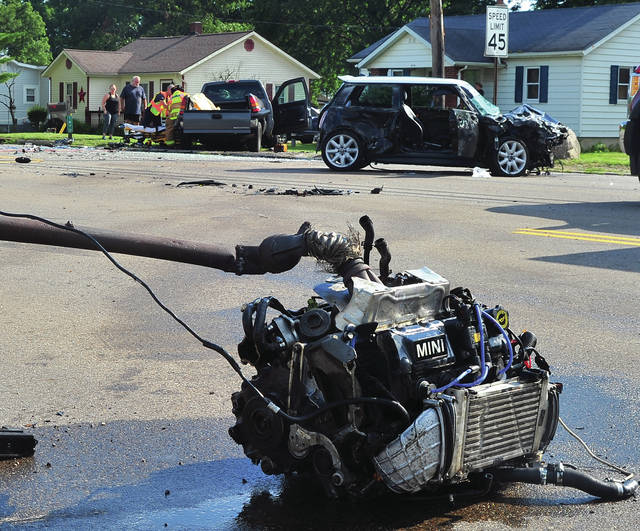 The engine from a Mini Cooper lies in the roadway, yards from the vehicle, after a crash on Co. Rd. 26-A south of Troy on Wednesday afternoon. The crash occurred around 5:30 p.m. when, according to multiple witnesses, a Mini Cooper was northbound on Co. Rd. 25-A at a high rate of speed, estimated at 80-90 miles per hour and weaving in and out of traffic. The Mini apparently swerved into the southbound lane in front of WACO Field, striking a southbound pickup truck head-on and narrowly missing a Jeep. Two persons were transported to Miami Valley Hospital aboard CareFlight. Their names and conditions are not known. Troy Fire Department and Troy Medics handled the scene. The crash is under investigation by the Miami County Sheriff's Office. ©2019 Miami Valley Today. All rights reserved