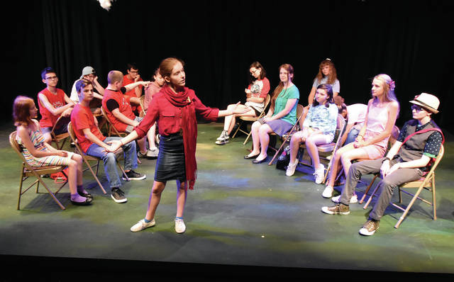 """Ellie Arnold, 12, of Troy, rehearses a scene with the rest of the cast from <em>""""</em>High School Musical<em>""""</em> at the Barn in the Park on Wednesday. The performance is being put on as part of the city of Troy's Recreation Department's Musical Theater. Two performances, at 2:30 and 6:30 p.m. will be offered on Thursday at the Barn in the Park in Troy Community Park. During the summer program, children learn the basics of acting, singing, dance and stage craft. Every child gets a part appropriate to their skill level and desires."""