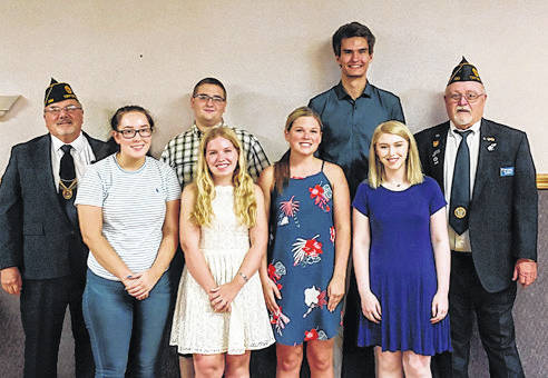 Provided photo Scholarship recipients front row Kaleigh Otstot, Victoria Jacobs, Carlie Weir and Emily Burleson. Back Row Legion Chairman Harlan Purves, Chace Trent, Jonathan Trimbach and Post 586 Commander Bob Steggemann. Not pictured recipients are Kayla Mullen and Alexis Otstot.