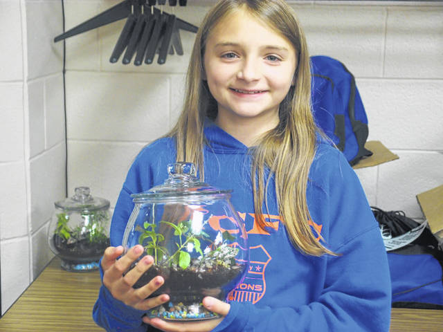Provided photo Jillian Bowser of West Milton with a terrarium she learned to build at the Milton-Union Public Library.