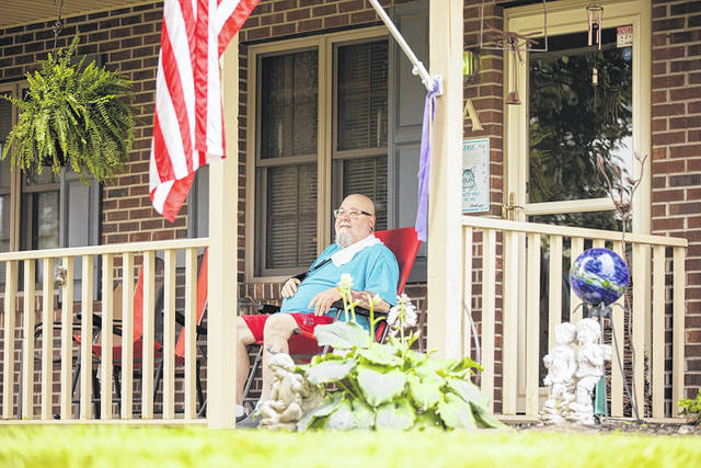 Provided photo Scott Sales relaxes on his porch in Troy.