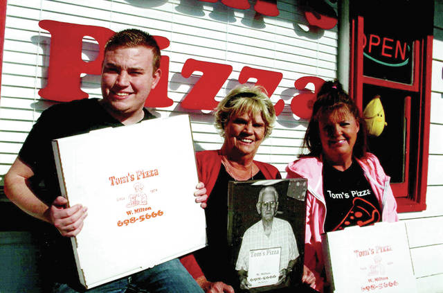"Mike Sakal | Miami Valley Sunday News Jake Stevenart, Carol Haworth and Sheri Haworth continue to move toward the future of Tom's Pizza at 690 S. Miami Street in West Milton. Tom's Pizza, which was opened by Thomas ""Tom"" Henry Manning on Feb. 13, 1974, recently celebrated its 45th anniversary and now has a fourth generation family member helping fill the orders. Thomas ""Tom"" Henry Manning stands in front of his popular West Milton business, Tom's Pizza, in 2002. Manning, who opened Tom's in 1974, worked inside his pizzeria well into his 80s and was the ""Oldest Pizza Delivery Boy in America,"" according to Pizza Today Magazine. Manning passed away at age 90 in 2009."