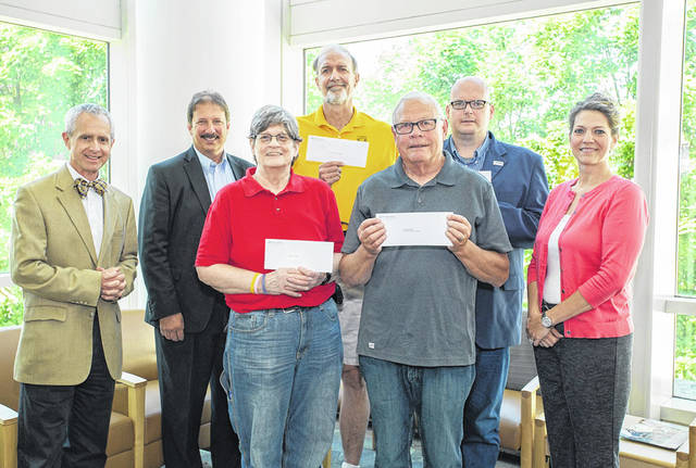 Provided photo Pictured, from left, are Dr. Mark Casdorph, event chair; Tim Snider, UVMC chief operations/finance officer; Cathy Larger, Bethany Center; Dick Steineman, St. Patrick's Soup Kitchen/Hobart Community Kitchen; Jim Sommers, Needy Basket of Southern Miami County; Bill Lutz, New Path Outreach; and Trish Wackler, UVMC chief nursing officer.