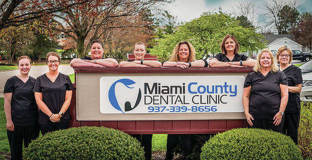 Provided photo Staff pose for a photo in honor of the Miami County Dental Clinic's newly redesigned website.
