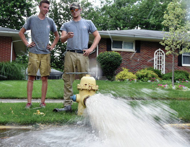 Troy Fire Department summer employees Eli Morando and Zane Drake flush fire hydrants in Westbrook on Tuesday afternoon. The pair will be spending most of their summer flushing and pressure testing the more than 2000 hydrants in the city ©2019 Miami Valley Today. All rights reserved