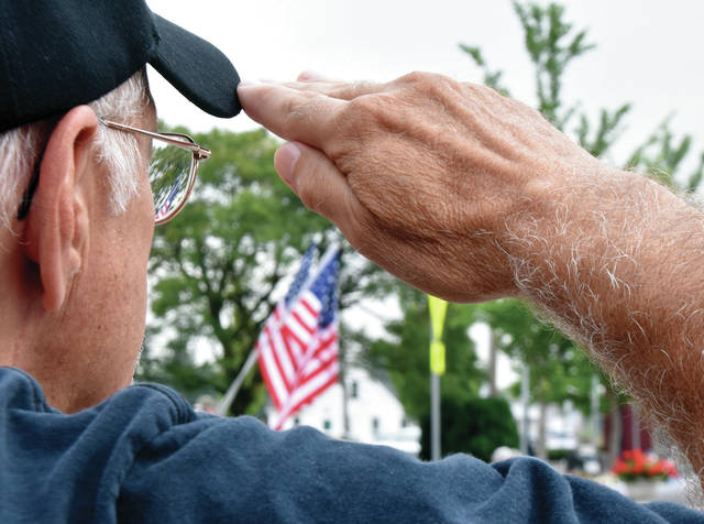 United States Army veteran Bill Surber of Troy salutes the Colors during Troys's Fourth of July Parade on Thursday. Surber served from 1966-69 and was a member of the 113th U.S. Army Band stationed at Fort Knox.. ©2019 Miami Valley Today. All rights reserved