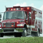 Man pinned under farm machinery