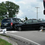 Crash causes damage, no serious injuries
