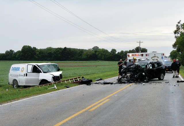 Deputies begin their investigation into a crash that resulted in two drivers deaths on Monday in the 6100 block of East State Route 41.