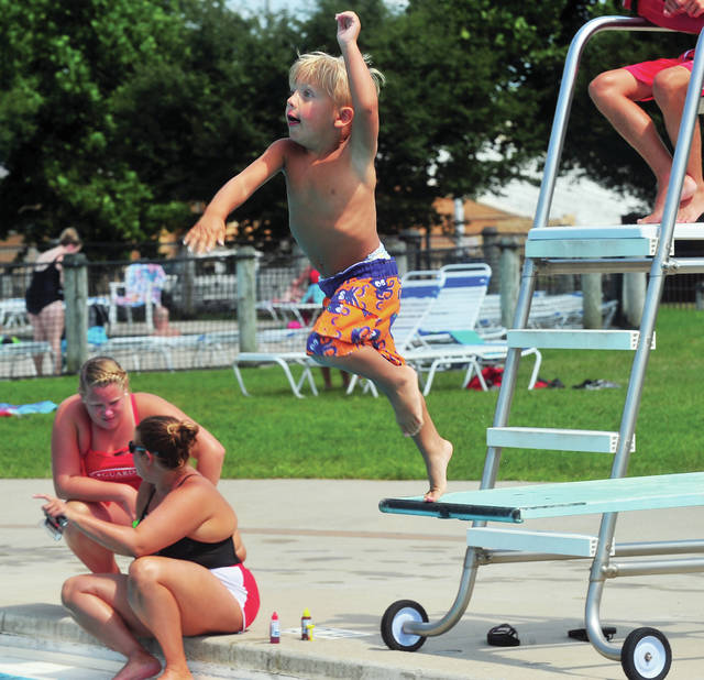 Three-year-old Jacob Kalmar of Troy takes a running leap of the diving board at the Troy Aquatic Pool on Thursday. ©2019 Miami Valley Today. All rights reserved