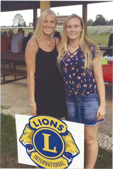 Provided phoyo Pictured are Troy Lions scholarship winners Madison Hildebrand, left, and Ashley Rowan.