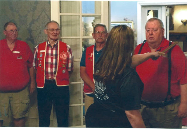 "Provided photo Pictured is District Governor-elect Jackie Christensen ""knighting"" Robert Medley as the Troy Lion's Club's new secretary. Looking on are fellow new officers Robert Dever, Fred Wackler and Jeff Feierstein."